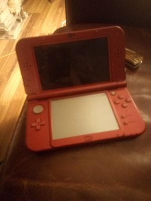 New Nintendo 3DS XL one game games downloaded on it and power cord for Sale in Benton, IL