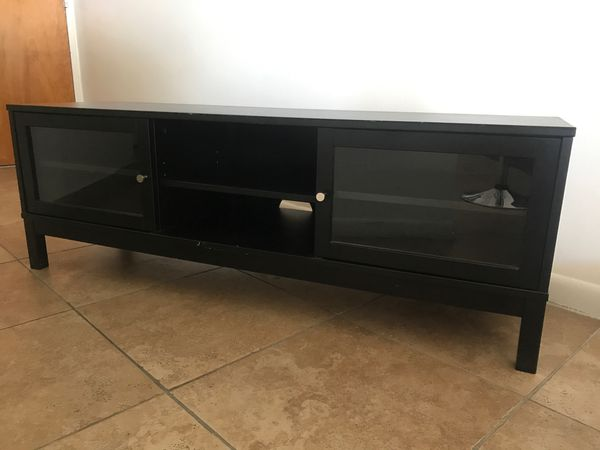 Tv stand with sliding doors