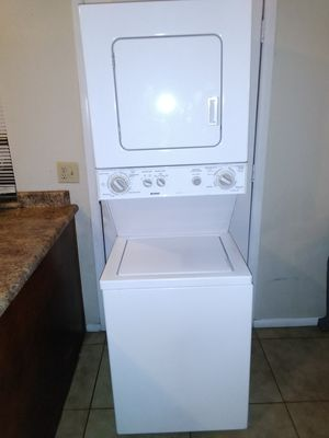 KENMORE, ELECTRIC STACKABLE WASHER AND DRYER COMBO. 24 Wide for Sale in Glendale, AZ