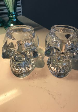 Set of two glass skull candle holders for Sale in Dallas, TX