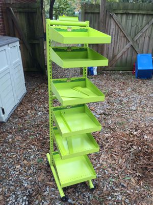 Green rolling rack with adjustable shelves great for w workshop or craft room or art supplies. for Sale in Cary, NC