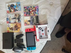 Nintendo Switch- wireless controller, Super Smash Bros, Outer Planet, Mortal Kombat, Pokemon Sword, Mario Kart deluxe, and Zelda Breath of the wild for Sale in Mesa, AZ