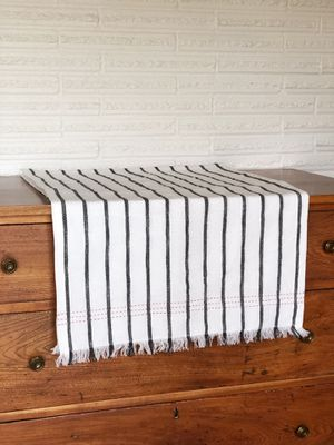 Brand new black and white striped table runner with red detailing on the end for Sale in Hillsboro, OR