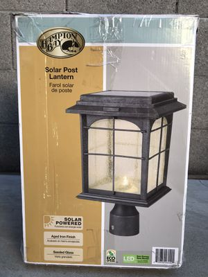 Hampton Bay Solar Outdoor Hand-Painted Sanded Iron Post Lantern with Seedy Glass Shade for Sale in Phoenix, AZ