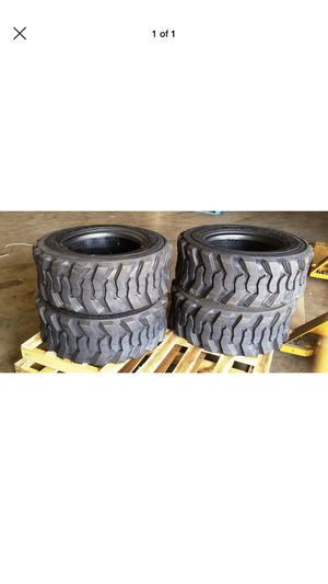 Four New Aftermarket Replacement 10-16.5 Skid Steer Tire with rim made to fit: Bobcat, New Holland, $1800 no bargain price firm for Sale in San Bernardino, CA