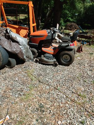 Husquavarna riding lawn mower it runs fast in reverse and slow in forward other than that a good mower and thats the price for Sale in Anderson, SC