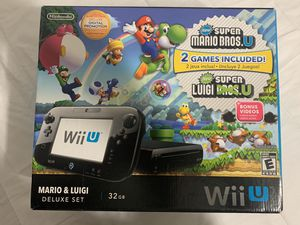 Nintendo Wii U that includes 25 games and 4 Wii remotes for Sale in Hialeah, FL