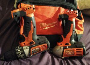 Milwaukee 18 volt cordless half-inch drive drill and impact gun Milwaukee bag32pc set socket with screw gun tips etc for Sale in Mount Vernon, WA