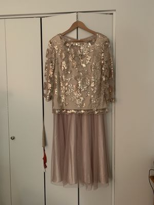 Silky glittery tea length size 16 dress. Wore once to my sons wedding one year ago. Kept in David's Bridal wrapping. Paid $340. Make offer. It's just for Sale in Pittsburgh, PA