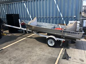 12 ft aluminum fishing boat w trailer and motor for Sale in Sun City, AZ