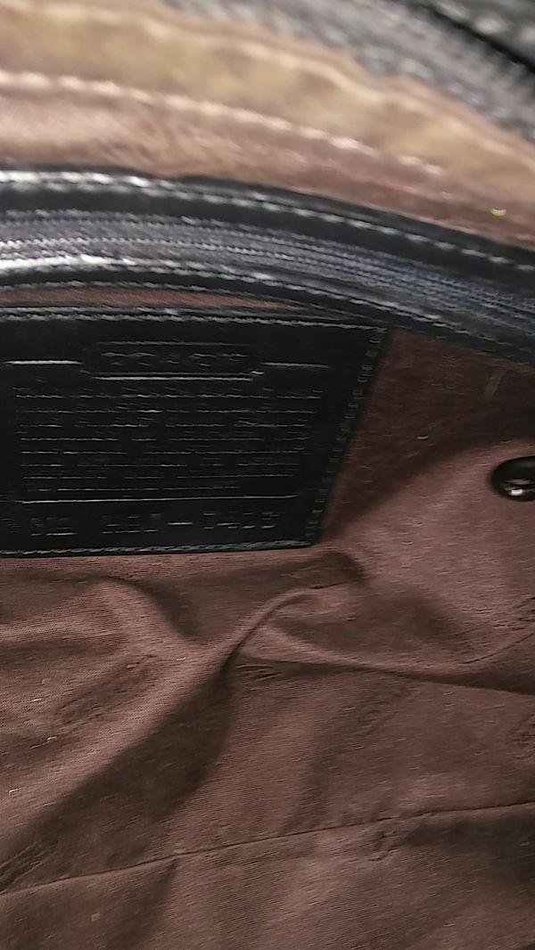 Coach. Black shoulder strap purse $45