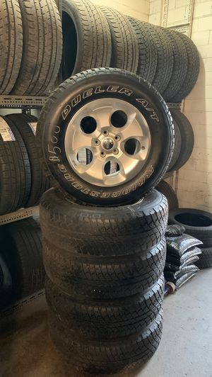Jeep wrangler wheels and tires for Sale in Lancaster, OH