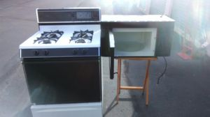 Self cleaning stove and microwave combo clean works great delivery is possible for Sale in Philadelphia, PA
