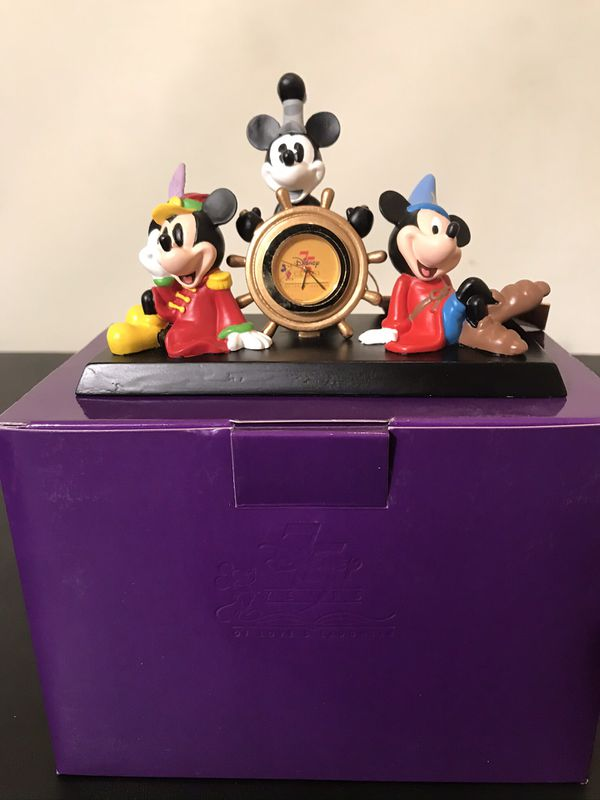 Disney Clock collectible and brand new with the box