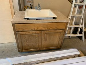 Oak cabinet with utility sink and faucet for Sale in Lakewood, WA
