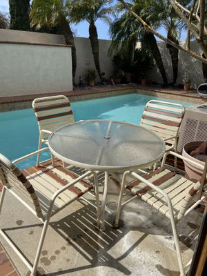 Vintage 70s chaise patio table and chairs pool aluminum frame w/vinyl covers outdoor furniture for Sale in Bellflower, CA