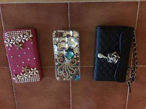All three for $15.. IPhone 5S phone covers for different occasions. One is adorned with rhinestones... So cute... for Sale in Apex, NC