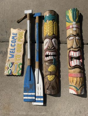 Tiki wall masks. Tiki sign and wood boat paddles Tiki Mask for Sale in Long Beach, CA