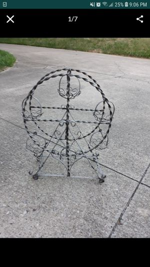 Vintage wrought iron ferris wheel plant stand for Sale in Elyria, OH