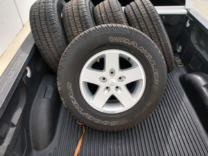 255/75/17 Jeep Wrangler OEM wheels 5 total 5x5 and tires price is firm pick up for Sale in Chino, CA