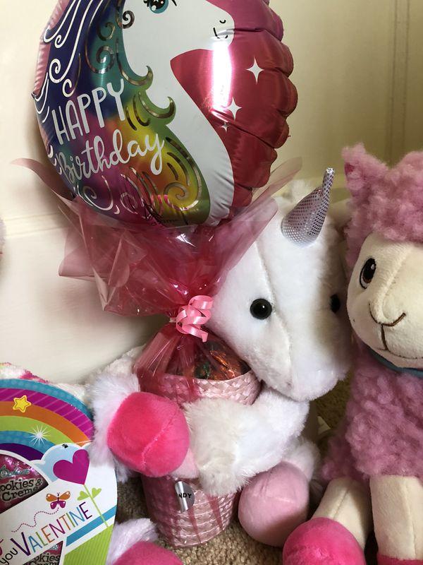 Plushies unicorns and llama