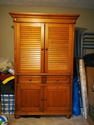 Solid pine armoire/wardrobe...repurposed entertainment center for Sale in Kennesaw, GA
