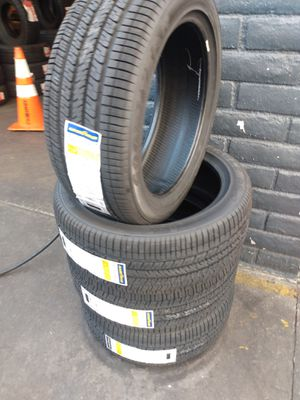 Set of new four tires Goodyear 215 45 17 free professional installation for Sale in Montebello, CA