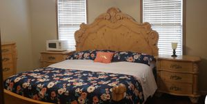 Real Hard wood King BR set for sale. Includes Headboard, footboard, sideboards, 2 nightstands, a triple dresser, a mirror and chest. $1000. 00 or be for Sale in Galloway, OH