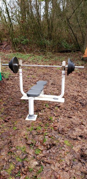 Tunturi MT 360 Bench Press and Olympic Weights and Barbell for Sale in Snohomish, WA