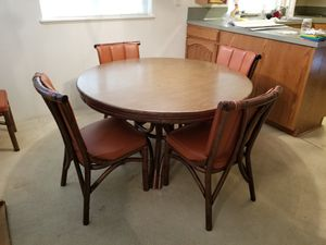 Kalp-Son Rattan Co. Round Table, 6 chairs with 2 leaves. Burnt Orange Leather Seat and Back. In excellent condition! 48 x 48 x 28.25H for Sale in Portland, OR