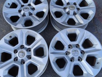 set of four 6 lug 17 inch Toyota 4runner alloy stock rims and caps. for Sale in Montebello,  CA