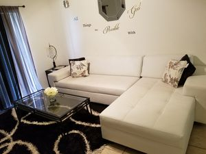 White couch...italian leather. With everything you see..rug coffee table 2 lamps everything included for Sale in Miramar, FL