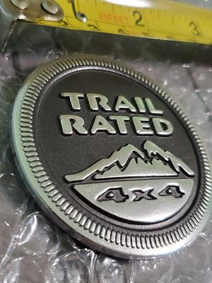 """2005 to 2014 Jeep Vehicles Mopar OEM Part #55157317AB""""Trail Rated 4x4"""" Badge emblem for Sale in Gurnee, IL"""