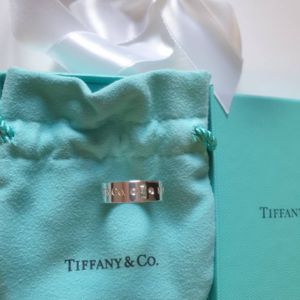 Authentic Tiffany & Co . Lock Diamond sterling silver ring size 6 for Sale in Queens, NY