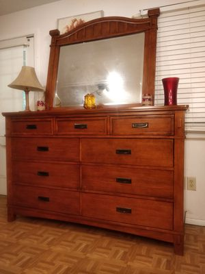 Like new modern wooden big dresser/TV stand with 9 drawers & mirror in great condition all drawers working well dovetail drawers driveway pickup. for Sale in West Springfield, VA