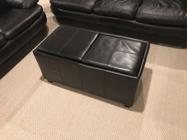 Black leather couches set with ottoman