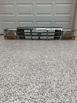 Ford OEM headlight kit right side and left side with OEM Grille for Sale in Tampa, FL