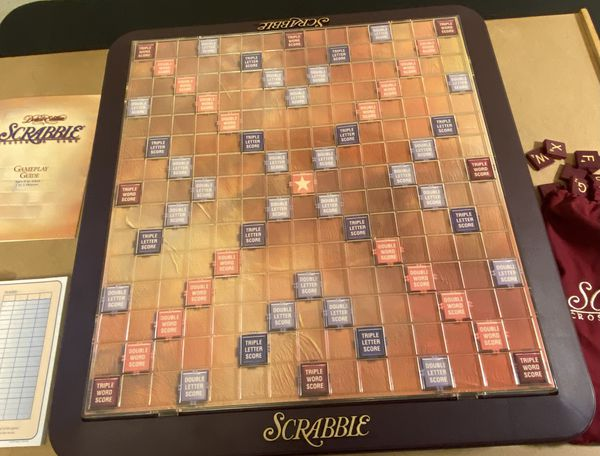 SCRABBLE DELUXE EDITION W/ ROTATING BOARD