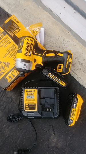 Dewalt xr impact 2 bateries 1 charger for Sale in Montclair, CA