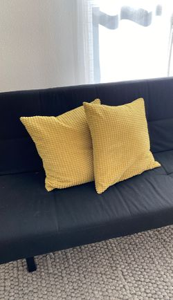 Two yellow pillows case and insides fluffy down mcm for Sale in Portland,  OR