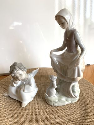 Lladro figurines (girl whit rabbit, retired Angel sitting) for Sale in Plainfield, IL