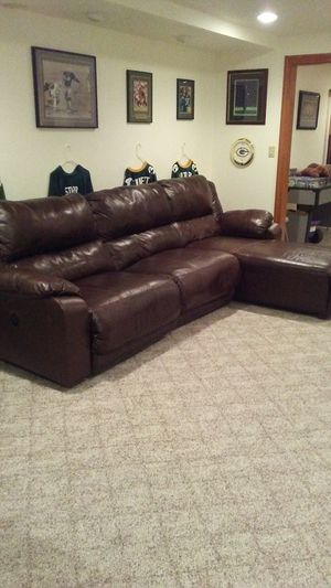 Brown leather sectional couch for Sale in Pewaukee, WI