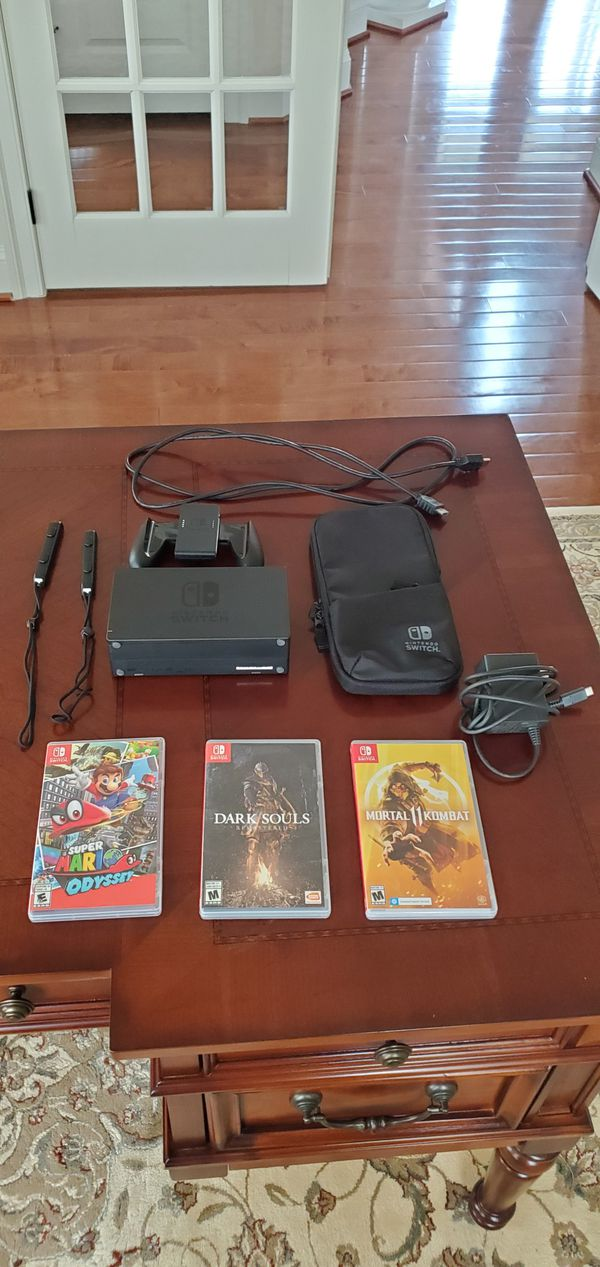 Nintendo switch with 3 games and carrying case (firm price)