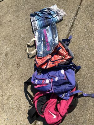 3 back packs , the silver cooler zipper has one side broken but the other still keeps food or drinks cold , and a beach blanket for Sale in Murfreesboro, TN