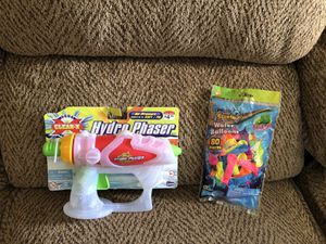 New water gun with water balloons for Sale in St. Peters, MO