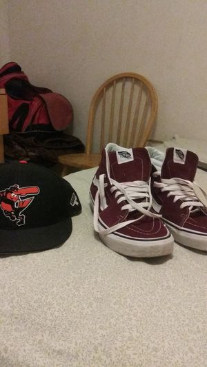 A pair of vans in good condition in a o's hat for sale .both items 20 bucks for Sale in Baltimore, MD