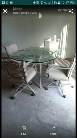 Glass table and 4 chairs for Sale in Sugar Creek, MO