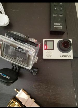 Gopro hero 4 silver used charger and case no trades pick up only for Sale in Long Beach, CA