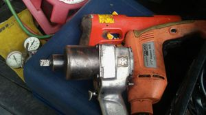 Three-quarter inch impact redhead cord drill and an air grinder for Sale in Orlando, FL