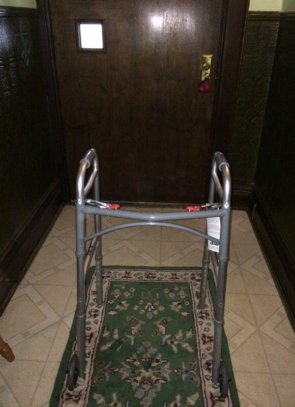 Adjustable walker with wheels.